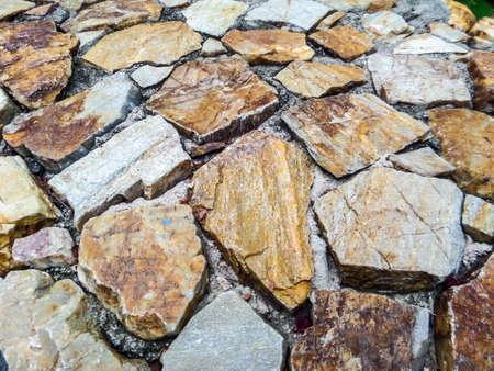 earth tone: Stone wall and earth tone color Stock Photo