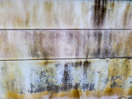 recieve: Old wall has rust and erode when recieve water from an artesian well or groundwater