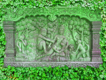 temperament: wood carving and clover background in the garden Stock Photo