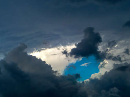 dramatic characters: Cloud and darkcloud dimension when sunsets and blue sky on back Stock Photo