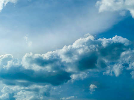 light complexion: Dark cloud and the blue sky and sunshine in summer Stock Photo