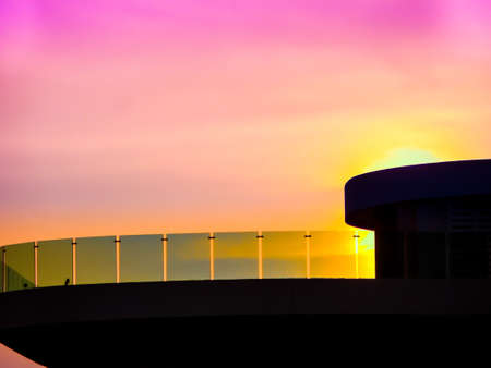 dish disk: roof and mirror terrace in pink purple sky background Stock Photo