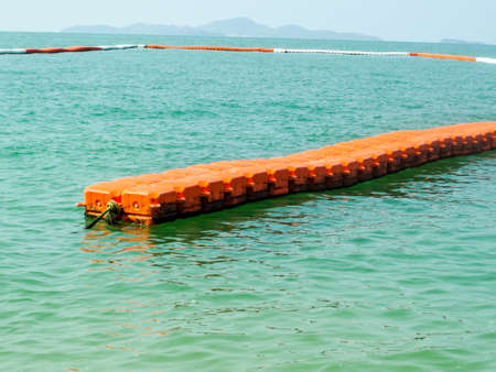 safty: vertical buoy barrier on sea surface to protect people from any boat