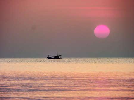 light complexion: sea sunsets fishing boat on horizon at seabreeze villa pattaya Stock Photo
