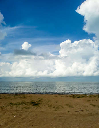 light complexion: White cloud and the blue sky and sea sand beach