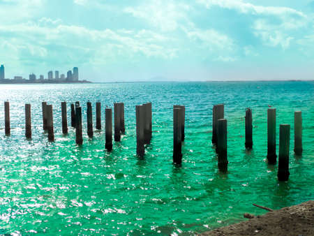 abandon: many seagull stand on abandon pillar and two color sea surface Stock Photo