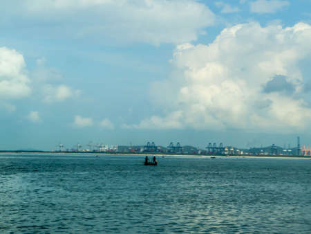 come home: Two fisherman on fishing boat come home on horizon line