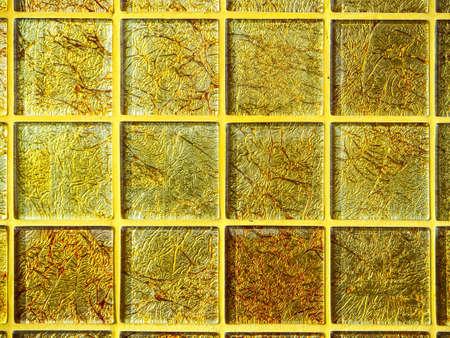 high class: Mosaic gold square block wallpaper luxury background high class interior Stock Photo