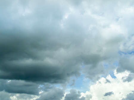 dramatic characters: dark cloudscape and light blue sky background