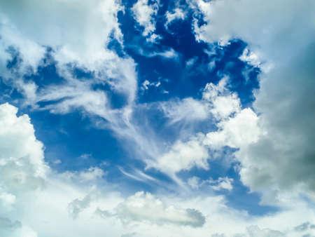 good heavens: cloudscape and light blue sky background