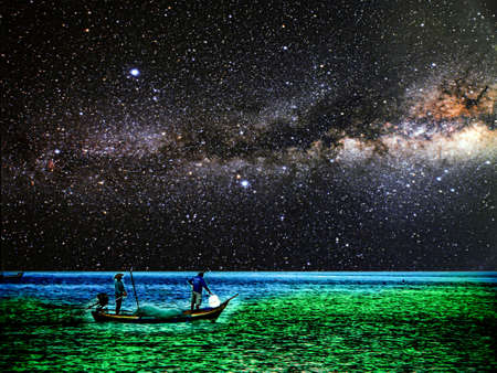 Fishing boat on horizon line between sky and ocean, Element of this image furnished by NASA