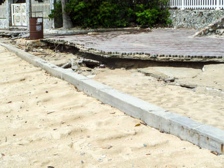 beachfront: Beachfront road and boardwalk damaged by storm surge
