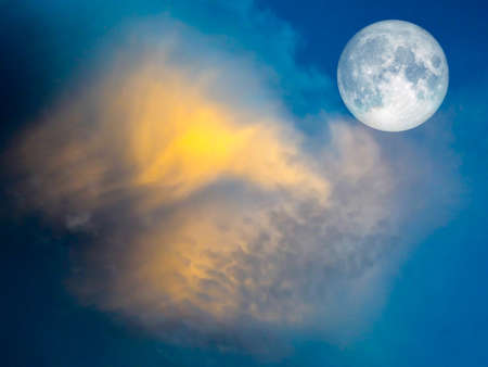 good heavens: full moon yellow cloud in the blue sky light of sunset in evening