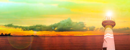 vintage landscape: lighthouse ebb tide sunset on horizon in sea panorama