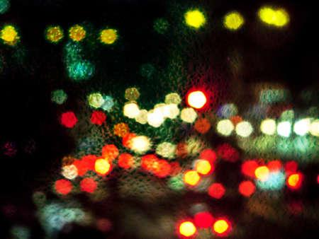 raindrop on glass and blur traffic jam background