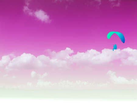 paramotor travel in the pink sky white heap cloud Stock Photo