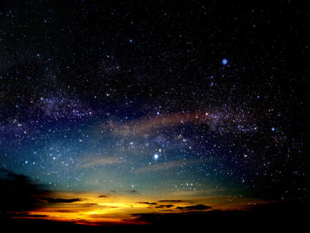 light of sunset cloud in night sky and stars on universe Stock Photo