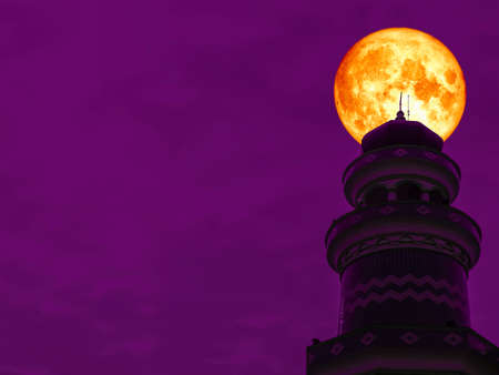 super blood moon back top of mosque clear night sky Stock Photo