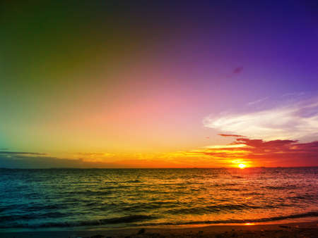 last light sunset on horizon line over sea and dark colorful sky Stock Photo