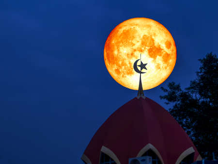 super full blood moon back top of moon star mosque