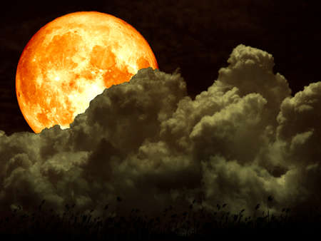 super full blood moon back on white heap cloud. Stock Photo