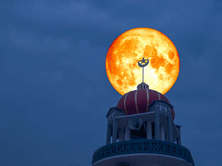 super full blood moon back top of mosque night sky Stock Photo