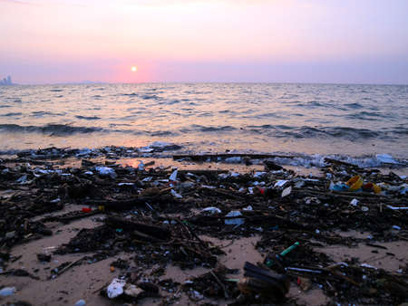foam plastic bamboo bottle glass garbage and waste pollution on beach