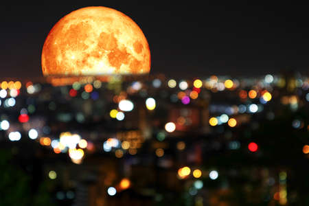 super blood moon and colorful of blur night light over city