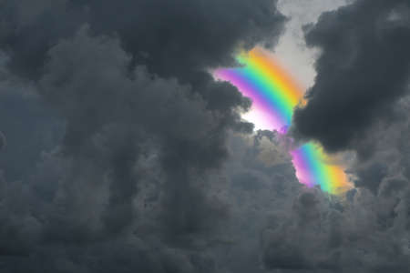rainbow back storm dark cloud on the sky ,concept problem and Threat ofthen has opportunity Stock fotó - 104825512