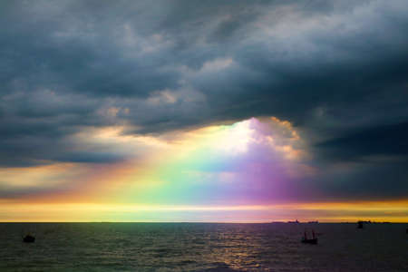 rainbow back dark cloud on sea. concept god bless, luck, wish, gift, lucky,