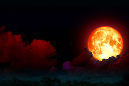 full strawberry moon back silhouette cloud in night sky
