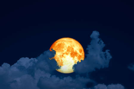 full blood moon back silhouette cloud on night blue sky Stock Photo