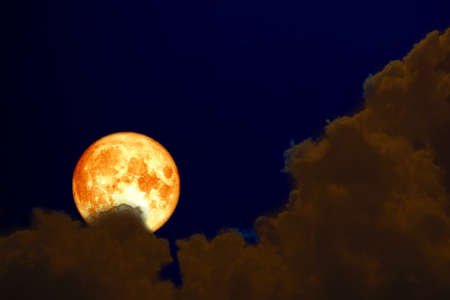 super full blood moon back over silhouette cloud night sky.