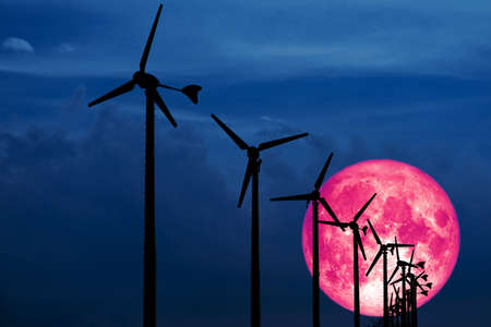 Old moon back Wind turbines produce wind energy which is a clean energy to replace coal and oil energy Stock Photo