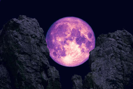 long night moon, cold moon back between two mountain night sky Stockfoto