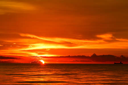 sunset on sea and ocean last light red and orange sky silhouette cloud 스톡 콘텐츠
