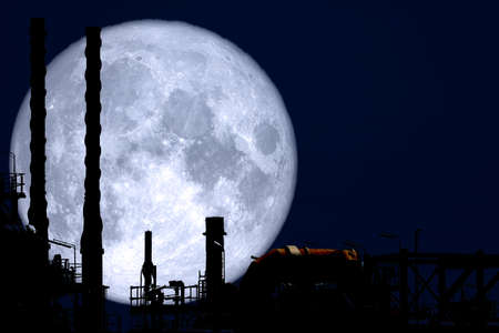 Full Strawberry Moon back on silhouette refinery on night sky