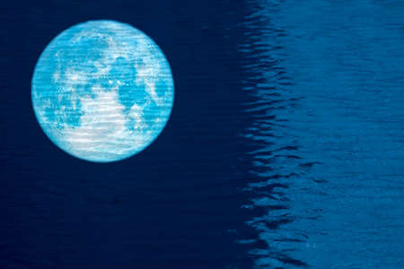 reflection full fish moon on water surface of swimming pool