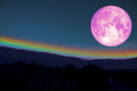 full milk blood moon silhouette hill and rainbow on night sky