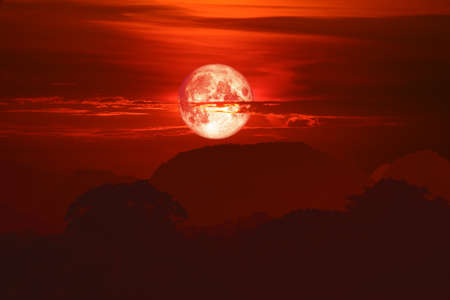 blood moon on night red sky back over silhouette mountain