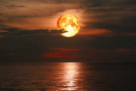 full blood moon on night sky over sea silhouette cloud 版權商用圖片