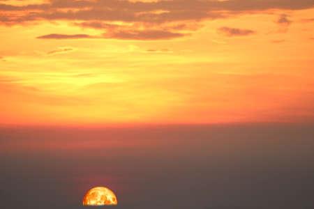 blood moon on night sunset sky back silhouette mountain