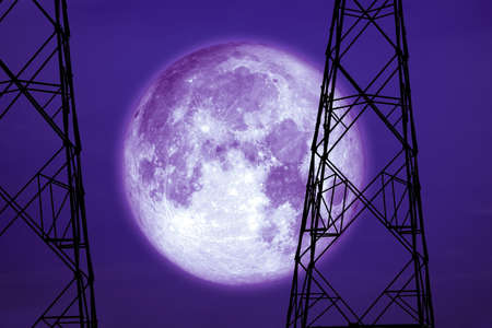 full harvest moon on sky and silhouette power electric pole