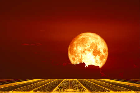 top table and harvest blood moon back on silhouette red orange cloud and night sky