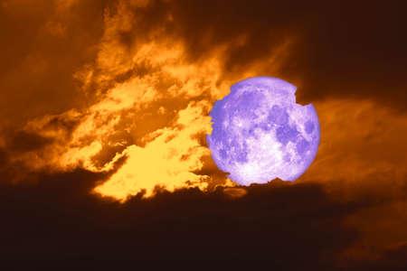 full harvest purple moon back on silhouette cloud on sunset sky