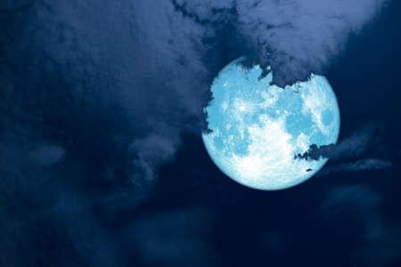 Full hay blue moon back silhouette white cloud night sky