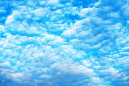 white spread heap cloud sunshine in summer blue sky soft cloud