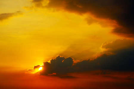 sunset on sky back dark silhouette evening cloud red orange yellow background