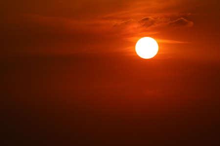 sunset on dark red orange sky back evening cloud over space