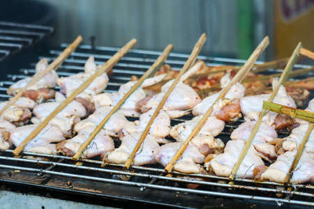 Grilled Skewer chicken and leg of chicken stick thai style barbeque on stove